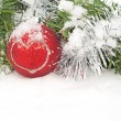 Christmas wreath and red bauble with a heart in snow — Stock Photo #8973407