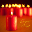 Red Christmas candle - with group of similar candles on background — Stock Photo #8973555