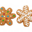 Snowflake shaped gingerbread cookies on white — Stock Photo #8973996