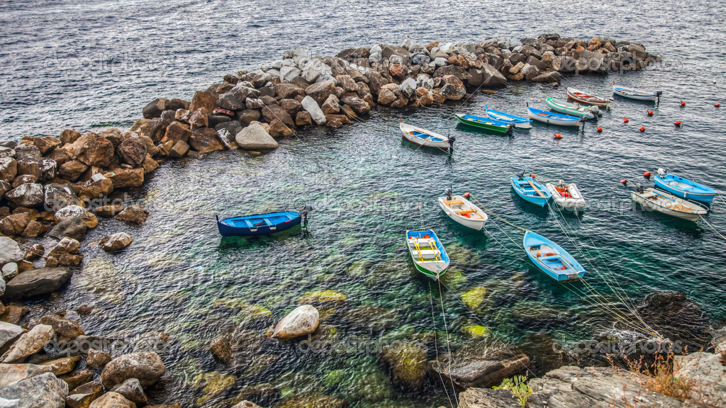 Small boats at Riomaggiore beach. Riomaggiore is one of the village of the famous Cinque Terre in Liguria, Italy  Stock Photo #14149970