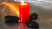 Zen Stone and Red Candle — Stock Photo