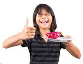 Little Girl Eating Dragon Fruit — Stock Photo