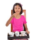 Little Asian girl drinking tea whit pleasure — Stock fotografie