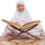Постер, плакат: Young Muslim Girl Reading Al Quran