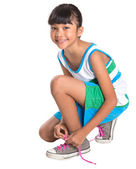 Young Girl Tying Shoe Laces — Stock Photo