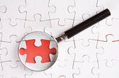 Missing Puzzle And Magnifying Glass — Stock Photo