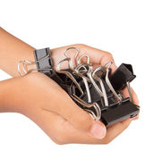 Female hand holding binder clips — Stock Photo