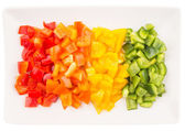 Colorful Chopped Capsicums In A Plate — Stock Photo