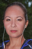 Portrait of a Mongolian woman with headphones — Stock Photo