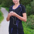 Jogger with mp3 and headphones — Stock Photo