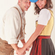 In love, laughing couple in Bavarian costume — Stock Photo