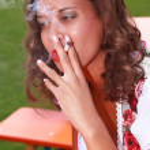 Young girl in smoke — Stock Photo