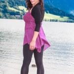 Fashionable older woman at the lake — Stock Photo