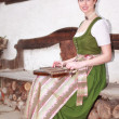 Young Bavarian girl playing the zither on a bank — Stock Photo