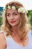 Portrait of a flower girl — Stock Photo