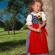 Stock Photo: Smiling little girl with charming Bavarian