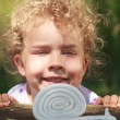 Smiling little girl with lovely curly blond hair — Stock Photo