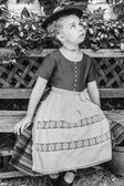Black and white portrait of a girl in a dirndl — Stock Photo