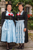 Two charming ladies in traditional dirndls — Stock Photo