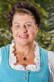 Portrait of a smiling lady in a dirndl — Stock Photo