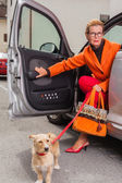 Stylish mature woman with her dog — Stock Photo