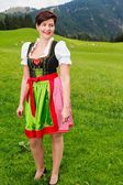 Beautiful woman in a colourful dirndl — Stock Photo