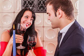 Romantic young couple drinking red wine — Stock Photo