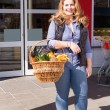 Beautiful woman shopping for groceries — Stock Photo #43591571