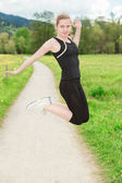 Fit female model jumping — Stock Photo