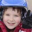 Stock Photo: Happy girl in blue helmet