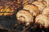 Mushromms on grill — Stock Photo