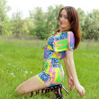 Young woman sitting on meadow — Stock Photo #11065279
