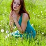 Young woman praying — Stock Photo #11644401