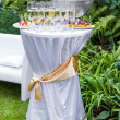 Table with champagne and appetizers — Stock Photo