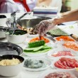 Cooking japanese sushi rolls — Stock Photo