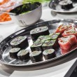 Dish with Japanese sushi rolls — Stock Photo