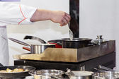 Chef prepares a meal — Stock Photo