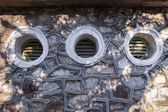 Granite wall with windows — Stock Photo