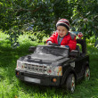 Boy rides on electric car — Stock Photo