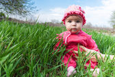Baby in a pink dress — Stok fotoğraf