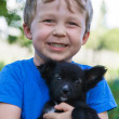 Portrait of boy with puppy — Stock Photo #25671441