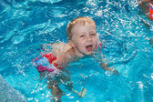 Boy swims in the pool — Stock Photo