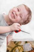 Boy catches fish in aquarium — Stock Photo