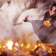 Witch jumping over the fire — Stock Photo #30001477