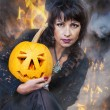 Witch holds a pumpkin — Stock Photo