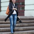 Young woman on stairs — Stock Photo