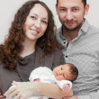 Mother and father holding newborn — Stock Photo