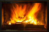 Burning billets in hot stove — Stock Photo