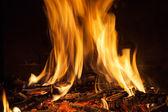 Burning billets in hot stove — Stock fotografie