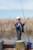Boy while fishing — Stock Photo